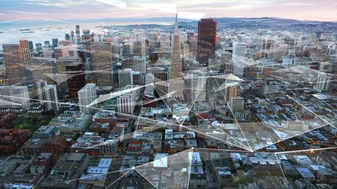 Aerial view of the financial district and the Bay Bridge of San Francisco with futuristic connections. California. United States. Skyline. Shot from helicopter. Technology.