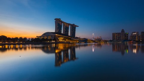 Beautiful and clear dawn time lapse of Singapore cityscape at Marina bay quay, Singapore. 4K UHD