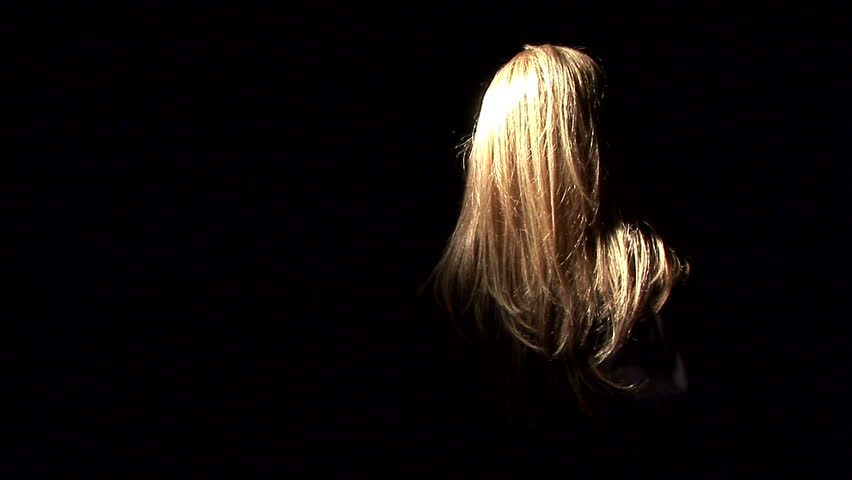 A ghostly, masked figure with long blond hair and a kitchen knife.