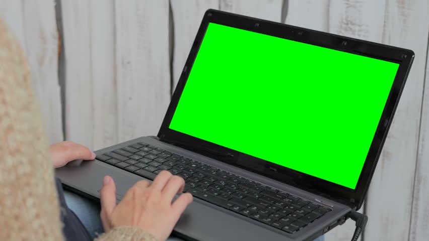 Woman using laptop with green screen.  | Shutterstock HD Video #25069532