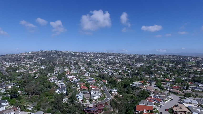 Panoramic aerial view from drone of Orange County beach city of San Juan Capistrano. Fly over coastal communities.