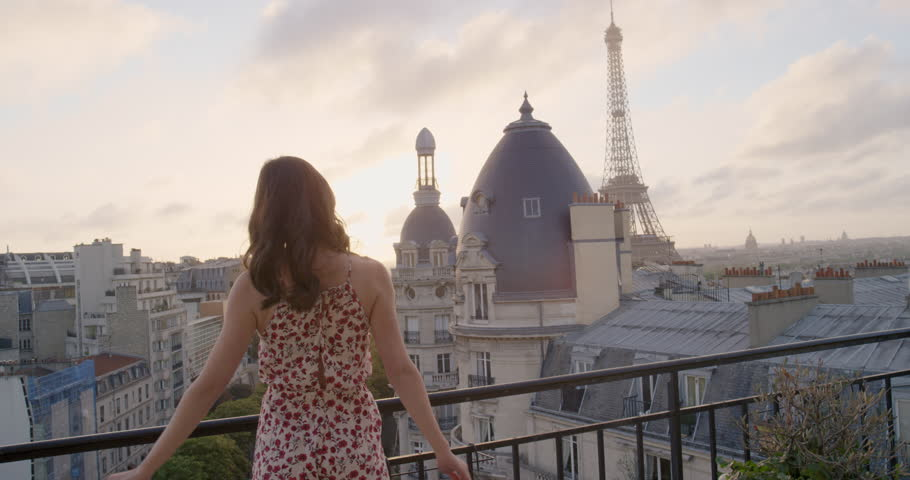 Young tourist woman arms raised looking at Eiffel Tower from Hotel Balcony enjoying european travel adventure celebrating beautiful city sightseeing exploration | Shutterstock HD Video #25126172
