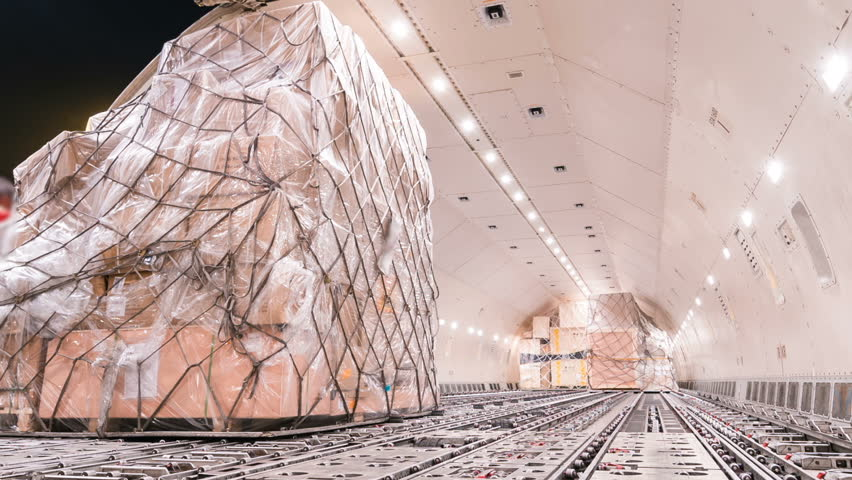 Zoom out time lapse unloading cargo inside cargo plane
