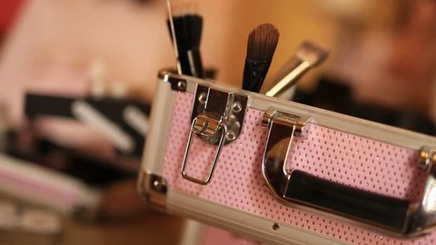 Professional make-up tools. A set of brushes, lipsticks, podvodok, shadows, carcass. Make-up artist doing make-up.