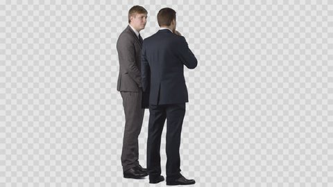 Two businessman's in office clothes are looking at something and discussing. Clip with alpha channel