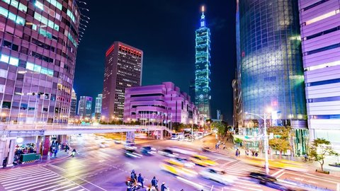 TAIPEI, TAIWAN -  (Timelapse View) By the corner of busy Taipei street after working hours with Taipei 101