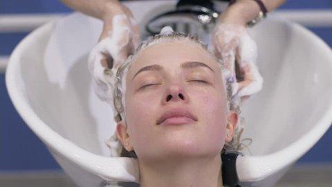 Washing blondie woman in the salon,  Make-up salon,