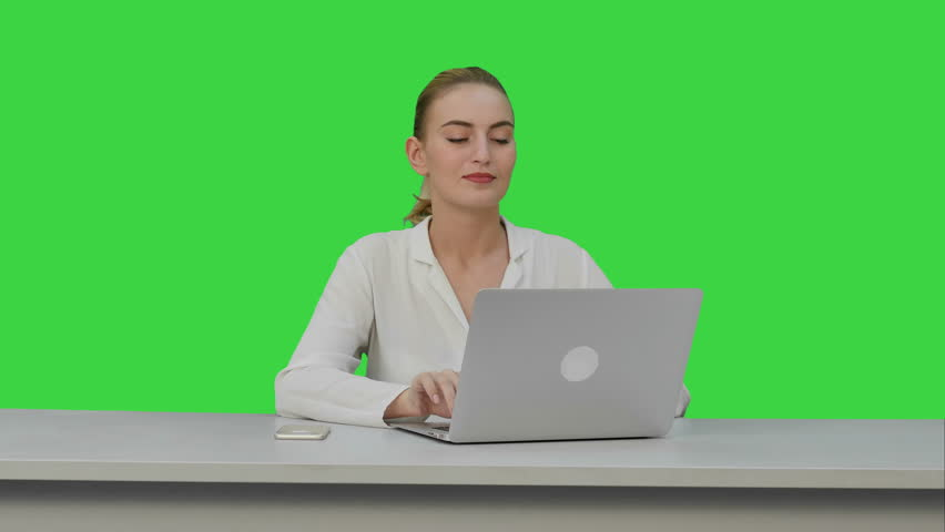 Positive businesswoman ready to work on laptop computer at the begining of day on a Green Screen, Chroma Key. | Shutterstock HD Video #25286672