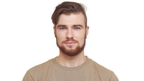 Handsome Caucasian male with brown beard and khaki t-shirt smiling on white background