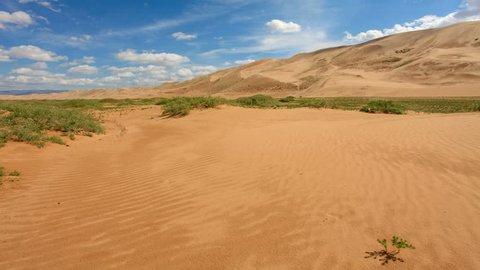 4K. Clouds over the Gobi desert, dune Hongoryn, Mongolia. Ultra HD, 4096x2304