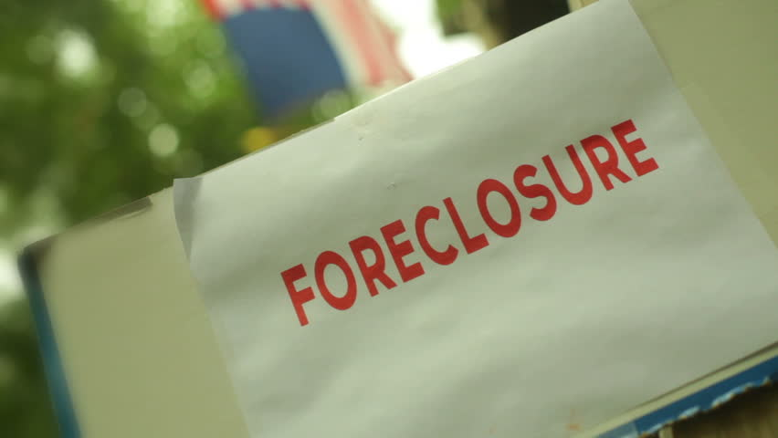 Foreclosure sign with American flag.