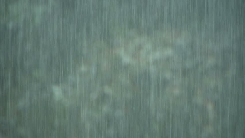 Heavy rain storm with green foliage in background