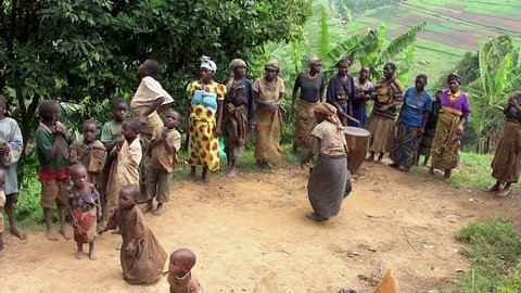 LAKE BUNYONYI, UGANDA - OCTOBER 21: Batwa pygmies dancing on October 21, 2012 at Lake Bunyonyi, Uganda. Pygmy people are ancient dwellers in the forests, they were known as The Keepers of the Forest.