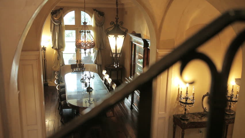 Looking down at the formal dining room in an expensive home