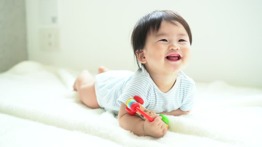 Baby playing with toy.