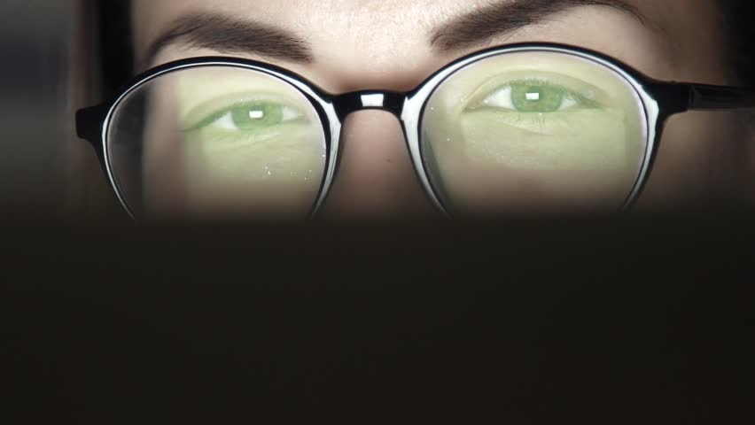 Closeup shot of woman in glasses surfing internet at night. Slow motion. | Shutterstock HD Video #25484042
