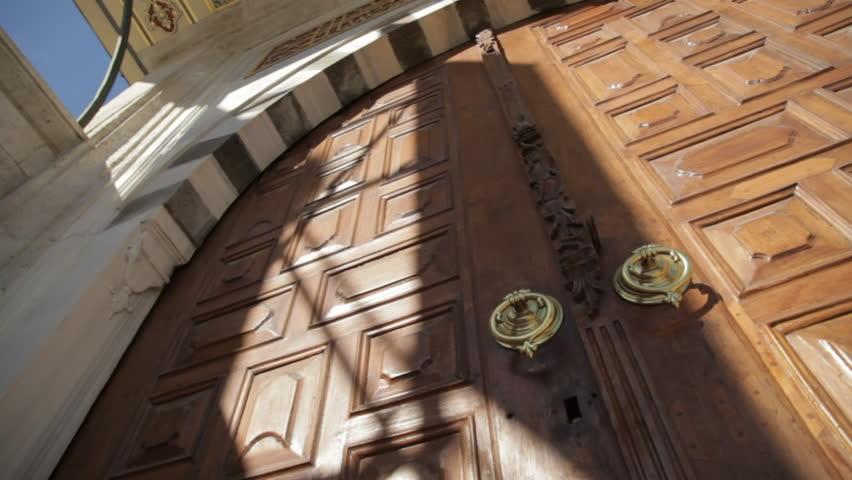 Big wooden arch door of a mosque   Shutterstock HD Video #25490342