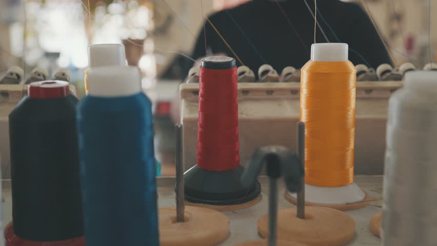 Embroidery machine in Garment Manufacturers. Embroidery machine needle in Textile Industry at Garment Manufacturers, Embroidery, Needle with thread. Embroidery machine on T-shirt in Textile Industry