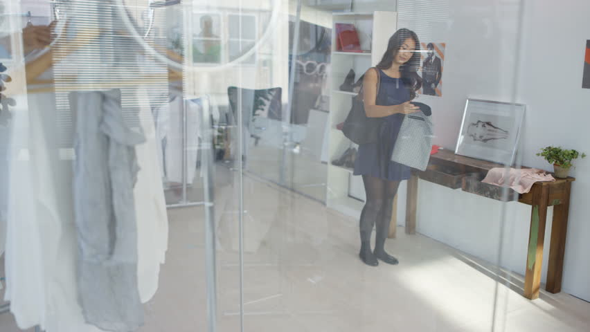 4K Male sales assistant helping female customer in fashion clothing store | Shutterstock HD Video #25529612