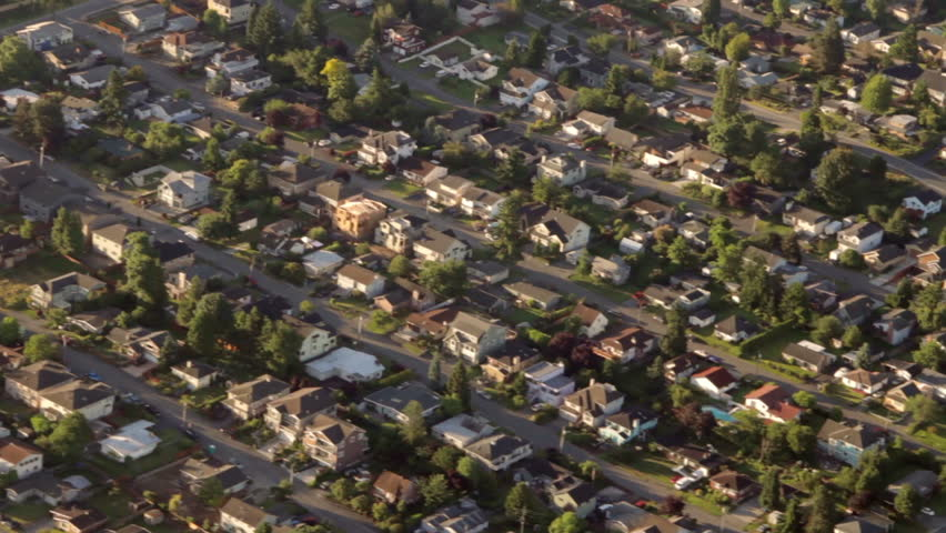 Aerial view from low-flying airplane of suburban neighborhood street and residential blocks | Shutterstock HD Video #2554622