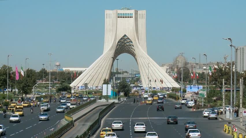 TEHRAN, IRAN   2013: The Azadi Tower With Car Traffic. The Azadi Tower