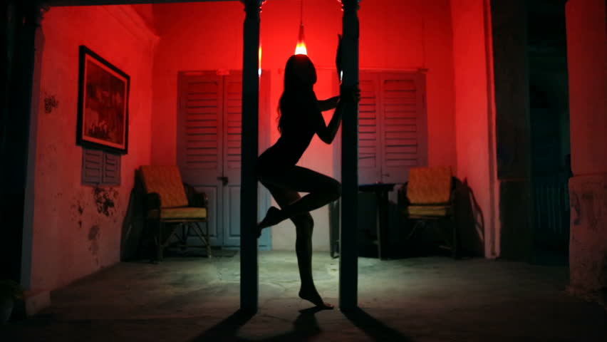 Sexy Woman Silhouette Dancing at the Hotel. Pole Dancer female Stripper in the Night brothel. Sensual Red light, noir style. Beautiful Dancing Girl with Sexy Body. Romantic Private dance, striptease.