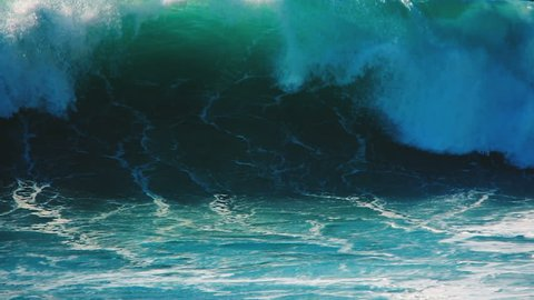 Big blue rough ocean surfing waves slowly splash, crash, break, roll tropical Hawaii beach. Slow motion close up video nature landscape background of blue, turquoise sea water surface moving power.