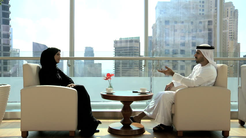 Arabic Male Female Couple Traditional Dress Hotel Lobby Drinking Coffee