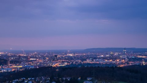 BASEL, SWITZERLAND – April 4, 2017: View of Basel at dusk until into night timelapse Basel skyline at afternoon to night