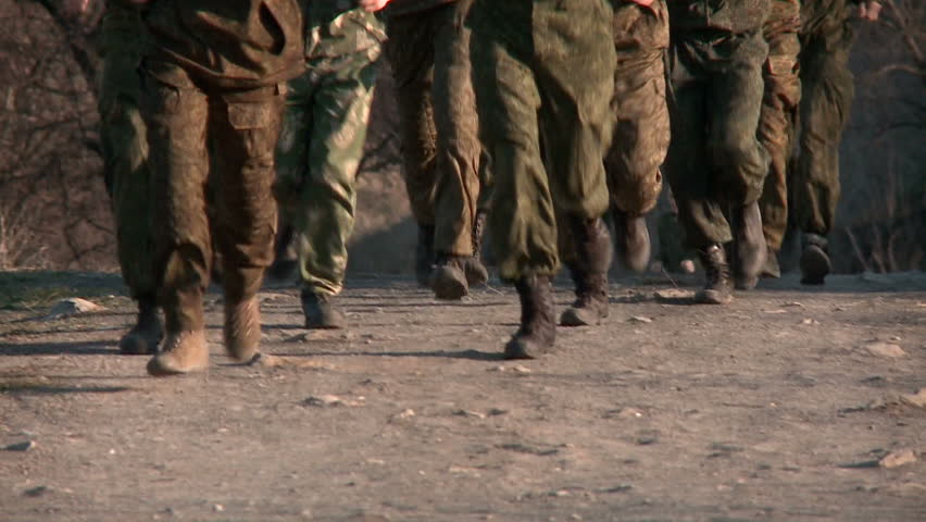 Soldiers training runs on the road. The boots only.