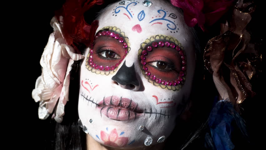 Beautiful woman with custom designed candy skull mexican day of the dead face make up