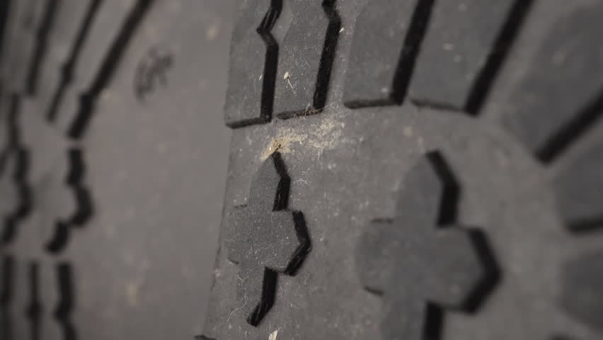 Rubber Boot sole close up stock footage. A rubber sole in extreme close up with a sliding camera move.