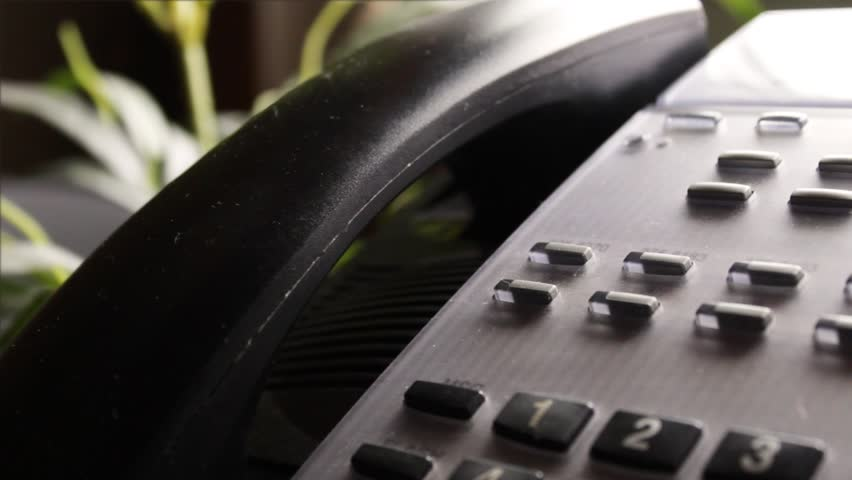 Multipurpose clip - medium shot of a office telephone hung up and picked up