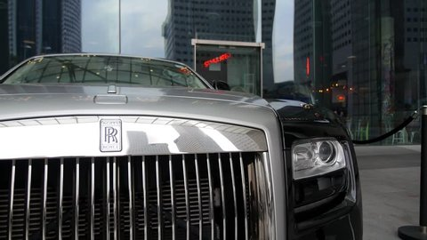 SINGAPORE, JULY 23, 2016 - Rolls Royce Luxury Car on Street of Big City