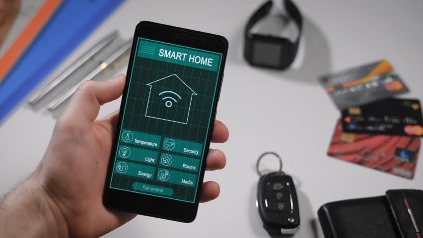 Smart home, application on the phone. A man manages various parameters of  his home