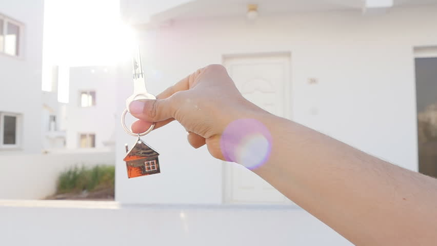 A hand is holding a key from the new home | Shutterstock HD Video #25691072