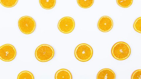 Swarm Fruits Are Dancing. Stop Motion Animation With Oranges and Kiwi on a White Background. Top View. 4K.