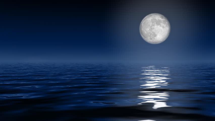 Big full moon over ocean