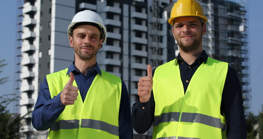 Optimistic Workers Men Show Thumb Up Sign Looking Camera Under Development Site