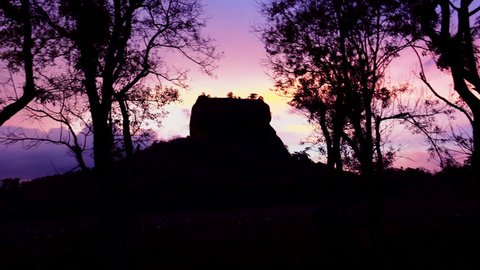 Amazing sunset panning video of Lion Rock with ancient fortress and temple famous world heritage in Sigiriya, Sri Lanka