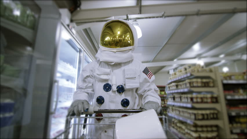 4K Off duty astronaut walking through supermarket, shopping for groceries