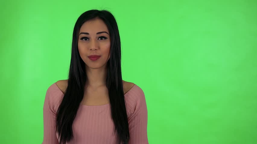 Young attractive asian woman points to camera - green screen studio | Shutterstock HD Video #25749362