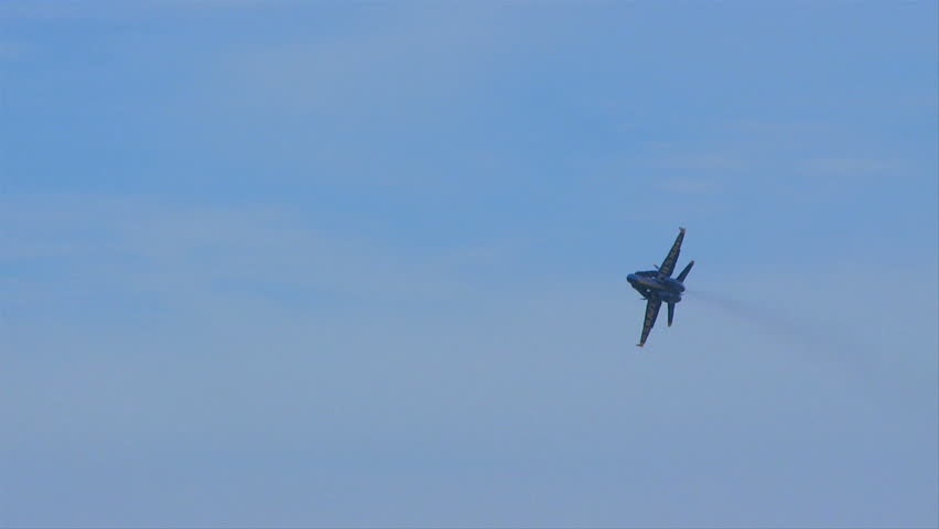 QUONSET, RHODE ISLAND - CIRCA JUNE 2012: Blue Angels - 6 single jet flyover with bottom angled to camera