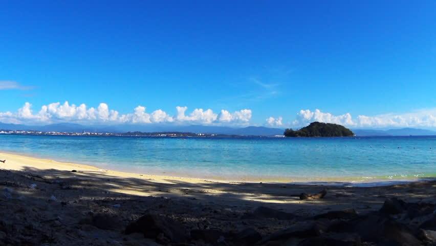MANUKAN ISLAND, KOTA KINABALU, MALAYSIA - JANUARY 10, 2017: The calm hot day on Manukan island, Borneo, the Sabah district of Malaysia, great place to chill