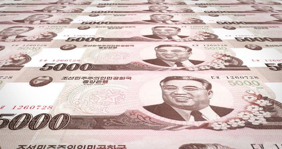 Banknotes of five thousand wons of North Korea rolling, cash money, loop