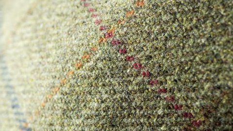 Tweed texture background stock footage. Wool Tweed texture backdrop in extreme close up with a sliding camera move.