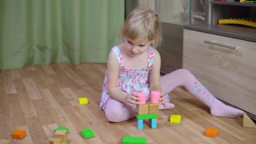 Little Girl Plays With A Designer 4k