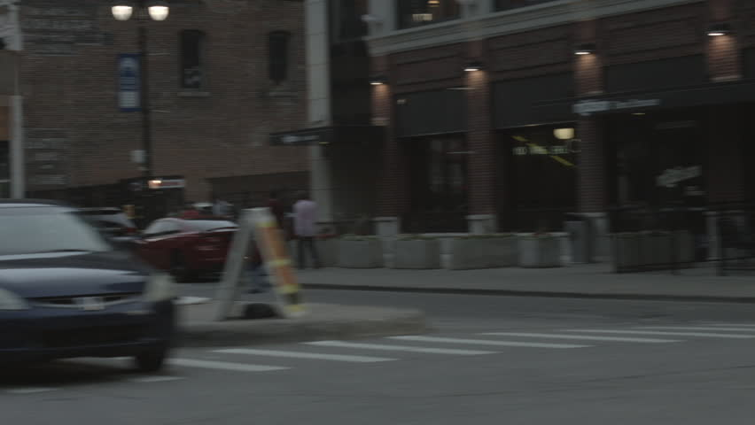 DETROIT, MI - CIRCA 2014: Driving plate: right 3-quarters. Down town at dusk past night life, parking, bars, restaurants, commercial property.  Mid West, overcast.  24mm lens, stabilized | Shutterstock HD Video #25874282