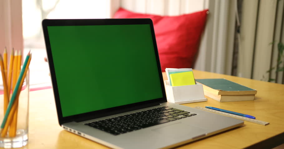 Close up man hands using laptop with a green screen standing on the table and drinking coffee | Shutterstock HD Video #25903100