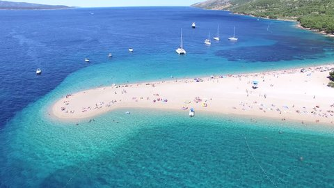 BOL, CROATIA - AUGUST 1, 2014: Aerial view of people swimming and sunbathing on a sandy beach on the island of Brac, Croatia